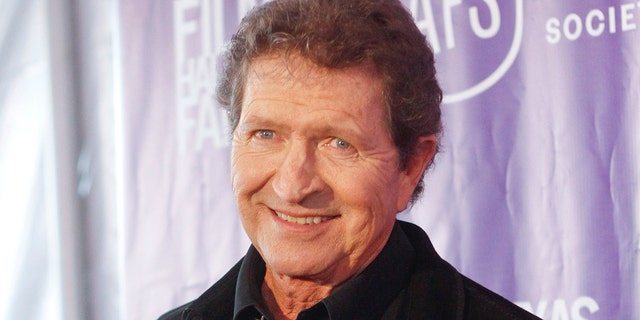FILE - Musician Mac Davis appears at the Texas Film Awards in Austin, Texas on March 6, 2014. Davis, a country star and Elvis songwriter, died on Tuesday, Sept. 29, 2020 after heart surgery. He was 78.