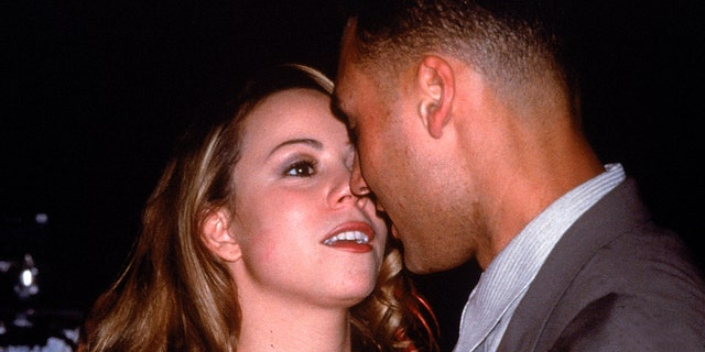 Mariah Carey and Derek Jeter at birthday party