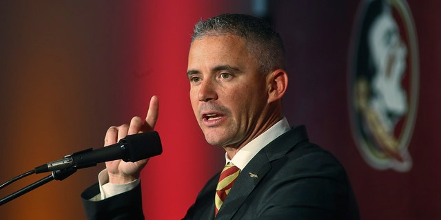 Seminoles coach Mike Norvell said this week he's asymptomatic for the coronavirus and planned to help with preparation and monitor practices remotely. Deputy head coach Chris Thomsen will fill in for him Saturday. (AP Photo/Phil Sears, File)