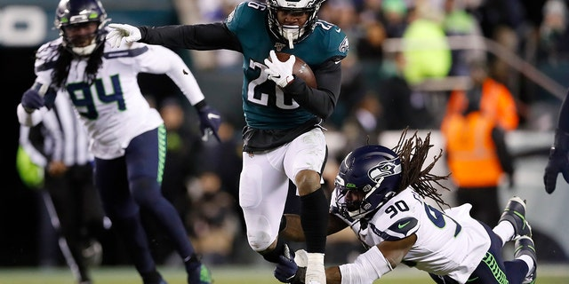 Miles Sanders shared running duties with Jordan Howard last season and still led all rookies in scrimmage yards, setting a Philadelphia Eagles franchise record in the category. He'll be the go-to guy in the backfield this year. Sanders is one of the league's rising stars. (AP Photo/Julio Cortez, File)