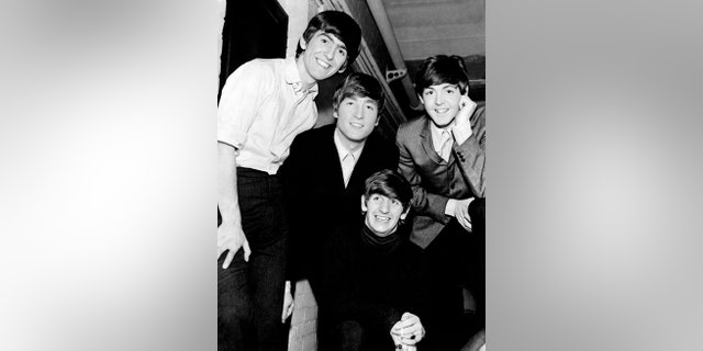 Portrait of English band The Beatles, the singers and musicians John Lennon, Paul McCartney, George Harrison and Ringo Starr .