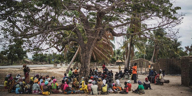 Residents gather for a meeting in the recently attacked village of Aldeia da Paz outside Macomia, on August 24, 2019. - On August 1, the inhabitants of Aldeia da Paz joined the long list of victims of a faceless Islamist group that has been sowing death and terror for nearly two years in the north of the country, which welcomes from September 4 the Pope. (Photo by MARCO LONGARI / AFP) (Photo by MARCO LONGARI/AFP via Getty Images)