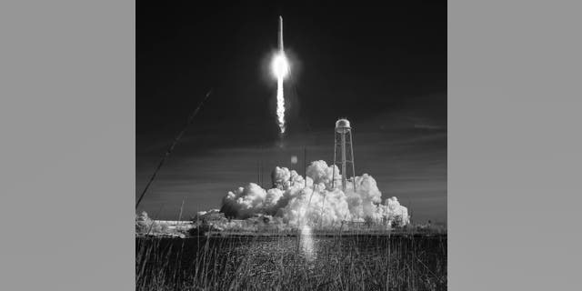 Northrop Grumman's Antares rocket, with Cygnus resupply spacecraft onboard, launches from Pad-0A, Wednesday, April 17, 2019 at NASA's Wallops Flight Facility in this black and white infrared photograph.
