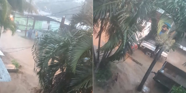 Rua inundada e chuva forte em Coxen Hole, na ilha de Roatan, em Honduras, enquanto Nana passava na quarta-feira.