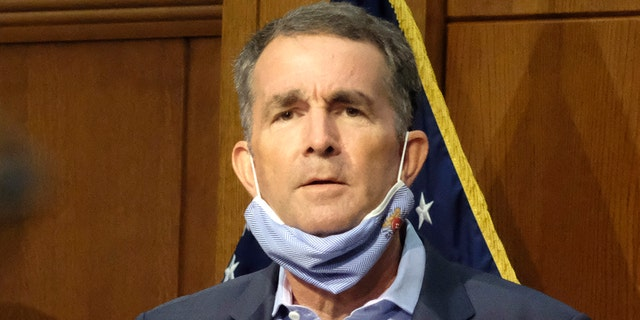In this Sept. 1, 2020 file photo, Virginia Gov. Ralph Northam listens to a reporter's question during a press briefing inside the Patrick Henry Building in Richmond. (Bob Brown/Richmond Times-Dispatch via AP)