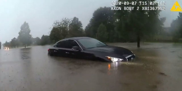A police officer in Pepper Pike, Ohio, helped rescue a motorist trapped in floodwaters on Monday.