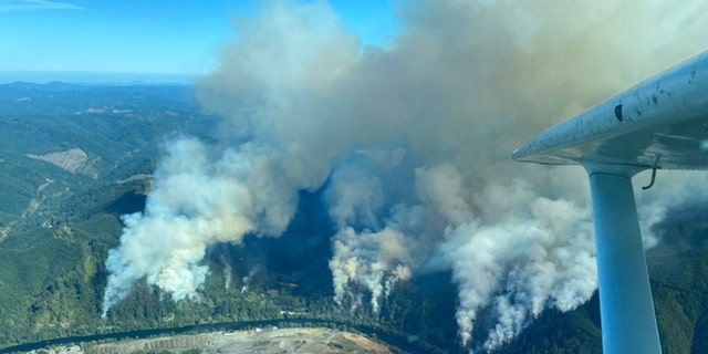The Sweet Creek Milepost 2 Fire burns in Oregon on Monday, Aug. 31, 2020.