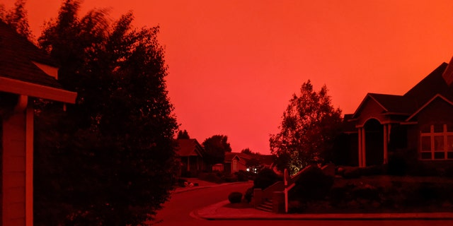 This photo taken from the home of Russ Casler in Salem, Ore., shows the smoke-darkened sky well before sunset, around 5 p.m., Tuesday, Sept. 8, 2020.