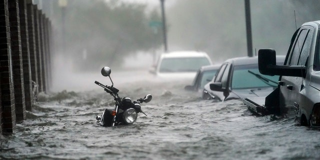 Flood waters move on the street, Wednesday, Sept. 16, 2020, in Pensacola, Fla.