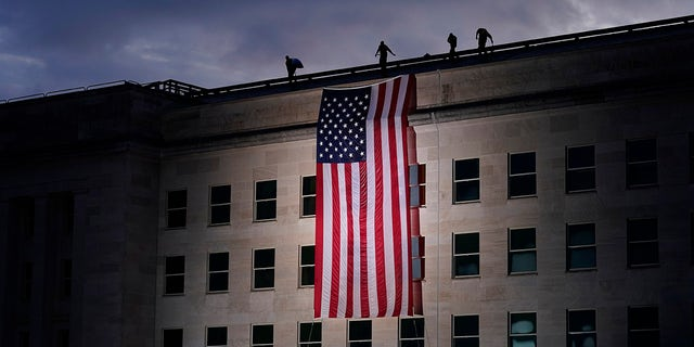 A large American flag is unfurled at the Pentagon (AP Photo/J. Scott Applewhite)
