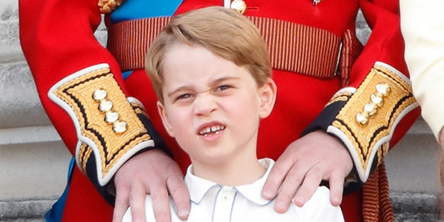 Prince George of Cambridge watches a flypast from the balcony of Buckingham Palace during Trooping The Colour