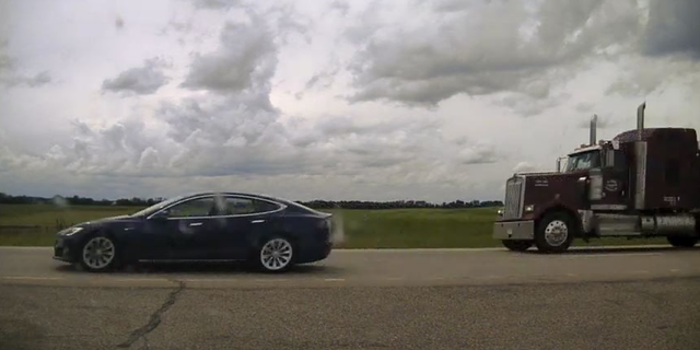 Photo of Tesla Model S with reclined seats.