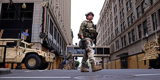 A member of the National Guard patrols the section of a downtown, after a grand jury voted to indict one of three white police officers for wanton endangerment in the death of Breonna Taylor, who was shot dead by police in her apartment, in Louisville, Kentucky, U.S. September 23, 2020. REUTERS/Carlos Barria