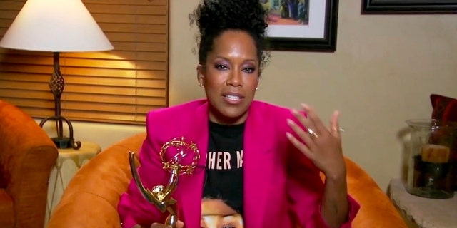 "In this video grab captured on Sept. 20, 2020, courtesy of the Academy of Television Arts & Sciences and ABC Entertainment, Regina King accepts the award for outstanding lead actress in a limited series or movie for ""Watchmen"" during the 72nd Emmy Awards broadcast."