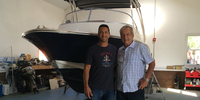 Rob and Nick Conzo in front of the Spudzy II after its post-Superstorm Sandy restoration.