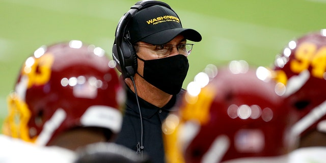 Washington Football Team head coach Ron Rivera talks with his players during the second half of an NFL football game against the Arizona Cardinals, Sunday, Sept. 20, 2020, in Glendale, Ariz. (AP Photo/Darryl Webb)