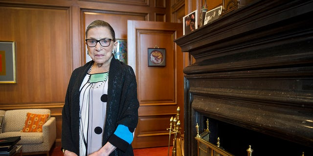FILE - In this July 31, 2014, file photo, Associate Justice Ruth Bader Ginsburg is seen in her chambers in at the Supreme Court in Washington. (AP Photo/Cliff Owen, File)