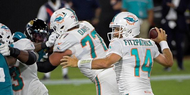 Miami Dolphins quarterback Ryan Fitzpatrick (14) throws a touchdown pass against the Jacksonville Jaguars during the first half of an NFL football game, Thursday, Sept. 24, 2020, in Jacksonville, Fla. (AP Photo/Phelan M. Ebenhack)