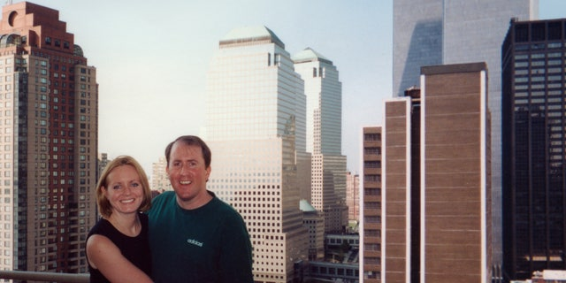 Christina Stanton and her husband Brian on their apartment terrace with the Twin Towers in the background just two weeks before the 9/11 terror attacks. Courtesy: Christina Stanton