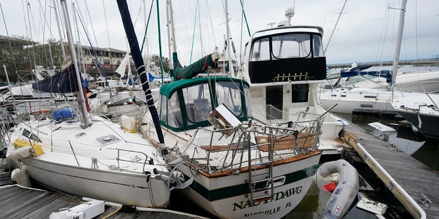 Storm damaged boats sit at the dock in a marina, Thursday, Sept. 17, 2020, in Pensacola, Fla.