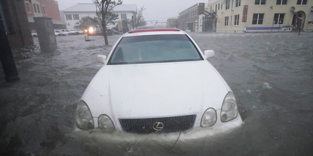 Floodwaters move on the street, Wednesday, Sept. 16, 2020, in Pensacola, Fla. as Hurricane Sally made landfall.