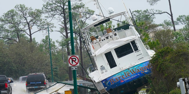 A boat is washed up near a road after Hurricane Sally moved through the area, Wednesday, Sept. 16, 2020, in Orange Beach, Ala.