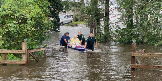 A man who was running out of oxygen was rescued from his flooded home after Hurricane Sally made landfall on Wednesday, Sept. 16, 2020.