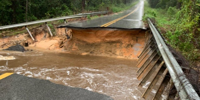 Roadways across Florida's Panhandle were washed out by heavy rain from Hurricane Sally.