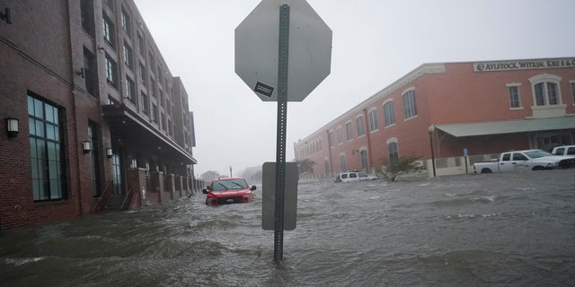 Floodwaters move on the street, Wednesday, Sept. 16, 2020, in Pensacola, Fla. Hurricane Sally made landfall Wednesday near Gulf Shores, Ala., as a Category 2 storm, pushing a surge of ocean water onto the coast and dumping torrential rain.