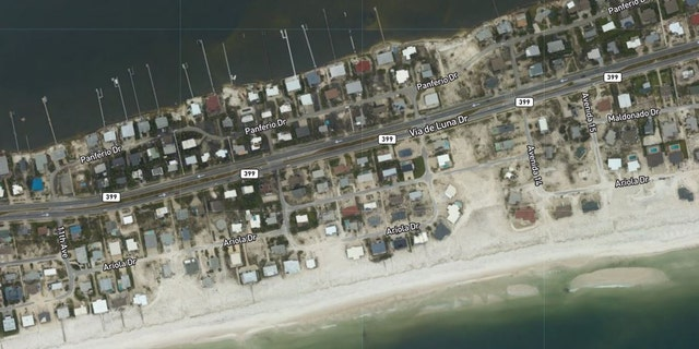 Sand was pushed around homes in Pensacola Beach, Fla., after Hurricane Sally roared through the region.