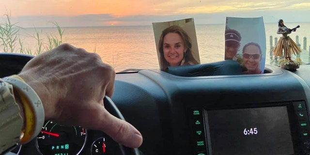 Scott Christmas had kept the photo of his late wife, Amy, on the dashboard of the Jeep for three years before lingering winds from Hurricane Sally blew it out of the vehicle.