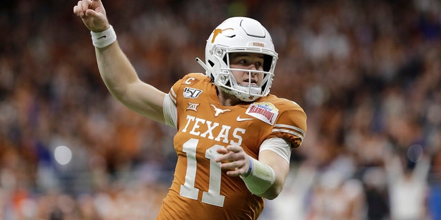 For Texas quarterback Sam Ehlinger, each day of summer workouts and training camp felt like uneasy steps toward a season that might never come. And even with his team's first kickoff coming Saturday night, Ehlinger holds his breath worrying that the coronavirus pandemic could still derail everything. (AP Photo/Austin Gay, FIle)