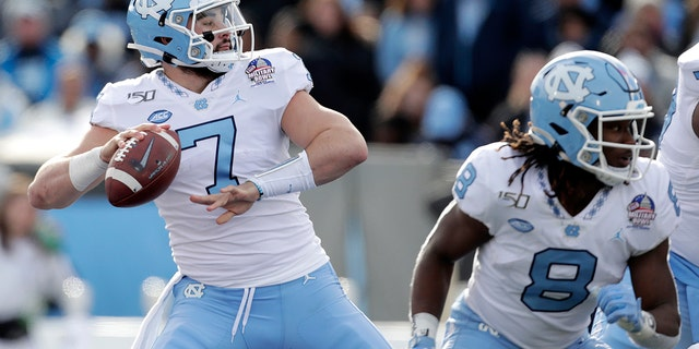 No. 18 North Carolina has plenty of hype with quarterback Sam Howell leading an offense full of returning playmakers for Mack Brown's second season. The Tar Heels open Saturday against Syracuse with a chance to prove the hype is deserved. (AP Photo/Julio Cortez, File)