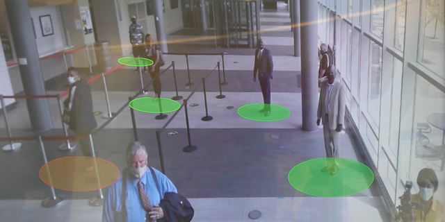 A social-distancing machine monitors if students are too close together.
