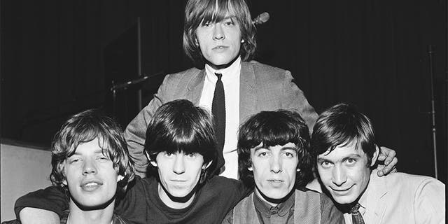 Group portrait of the Rolling Stones circa 1964. L-R Mick Jagger, Keith Richards, Brian Jones (back), Bill Wyman, Charlie Watts.