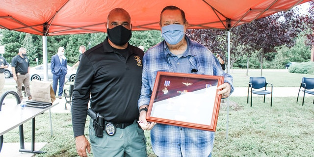 Detective Frank Corona, links, and retired Marine Corps. Lt. Kol. Thomas Faleskie.