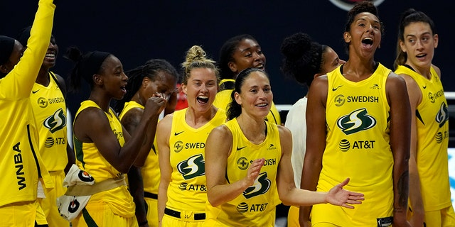 The Seattle Storm celebrate after the team defeated the Minnesota Lynx during Game 3 of a WNBA basketball semifinal round playoff series Sunday, Sept. 27, 2020, in Bradenton, Fla. The Storm move onto the WNBA finals. (Associated Press)