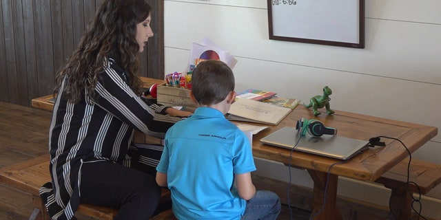 Teacher Madison Harris stops by the farm's schoolhouse twice a week to help with homework, classwork, and Spanish to English translation (Stephanie Bennett/Fox News).