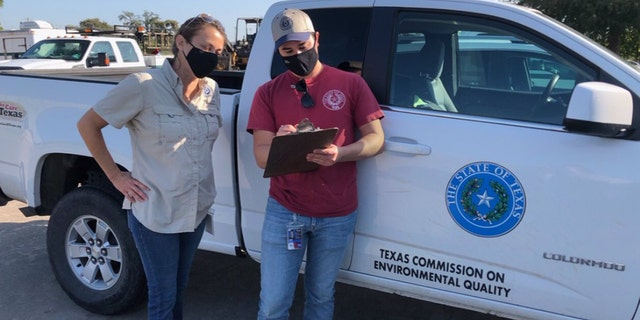 Investigators from the Texas Commission on Environmental Quality conduct water sampling in Lake Jackson, Texas on Sept. 26, 2020 after a brain-eating amoeba was detected in the city's water supply.
