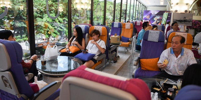 Diners eat at Thai Airways' pop-up restaurant inside the airline's Bangkok headquarters on Thursday.