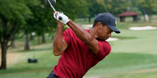 Tiger Woods hits from the tenth tee during the final round of the BMW Championship golf tournament at the Olympia Fields Country Club in Olympia Fields, Ill., Sunday, Aug. 30, 2020. (AP Photo/Charles Rex Arbogast)