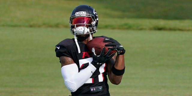 Atlanta Falcons running back Todd Gurley II (21) makes a catch during an NFL training camp football practice Thursday, Aug. 20, 2020, in Flowery Branch, Ga. (AP Photo/John Bazemore, Pool)