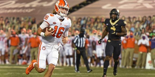 Clemson quarterback Trevor Lawrence scores against Wake Forest during the first half of an NCAA college football game Saturday, Sept. 12, 2020, in Winston-Salem, N.C. (Walt Unks/The Winston-Salem Journal via AP)