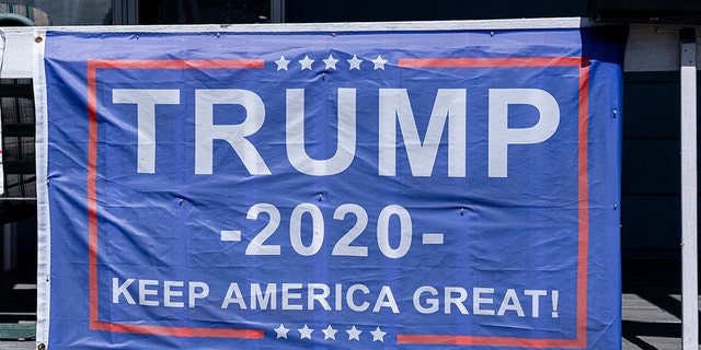 "A ""Trump 2020"" campaign flag attached to a railing Sept. 11, in Scranton, Pa. (Photo by Robert Nickelsberg/Getty Images)"
