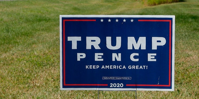 A sign supporting US President Donald Trump and US Vice President Mike Pence. (Photo by KAMIL KRZACZYNSKI / AFP) (Photo by KAMIL KRZACZYNSKI/AFP via Getty Images)