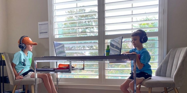 A 10-year-old and 7-year-old in Texas attending school virtually during the COVID-19 pandemic.
