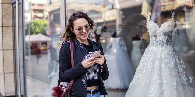 Talking about weddings was all fun and games until one anonymous Reddit user found out her mother and sister expected her to hand down her future dress. (iStock)