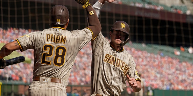 San Diego Padres' Wil Myers is greeted by teammate Tommy Pham (28) after hitting a home run off San Francisco Giants starting pitcher Drew Smyly in the second inning of a baseball game Sunday, Sept.. 27, 2020, in San Francisco. (AP Photo/Eric Risberg)