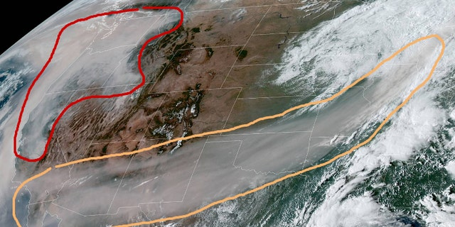 The satellite image showing the wildfire smoke. The area in the orange contour is smoke in the mid-upper levels of the atmosphere that has reached Michigan, according to the National Weather Service Weather Prediction Center, which notes that the red contour shows dense smoke near the West Coast.