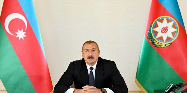 In this photo provided by Azerbaijan's Presidential Press Office provided on Sunday, 씨족. 27, 2020, Azerbaijani President Ilham Aliyev addresses the nation in Baku, Azerbaijan.